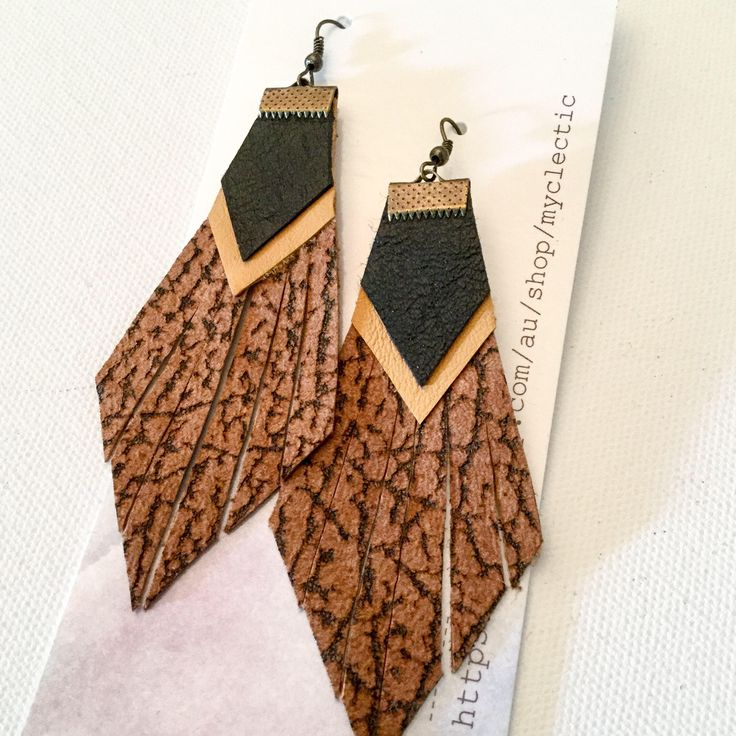 A personal favourite from my Etsy shop https://www.etsy.com/au/listing/558237668/tan-leather-tassel-earrings-black