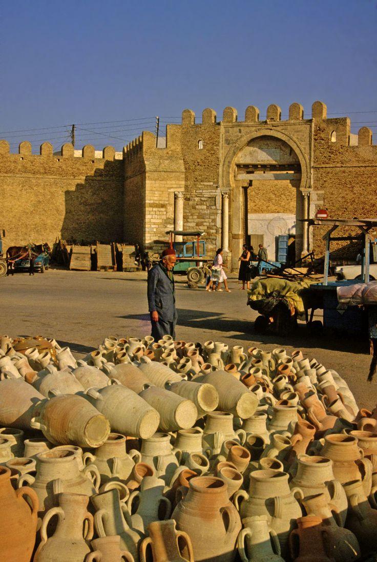 Pots for sale by the city gate in Kairouan, Tunisia 1983 https://www.amazon.com/s/ref=nb_sb_ss_c_3_12?url=search-alias%3Ddigital-text&field-keywords=neil+rawlins&sprefix=Neil+Rawlins,stripbooks,298