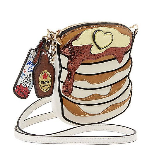 """Got syrup? If you said """"of course!"""" then we have the perfect purse for you: this faux leather flapjack stack of a bag by Betsey Johnson! From the heart-shaped pad of butter to the maple syrup and whipped cream hang-tags, it's simply delicious!"""