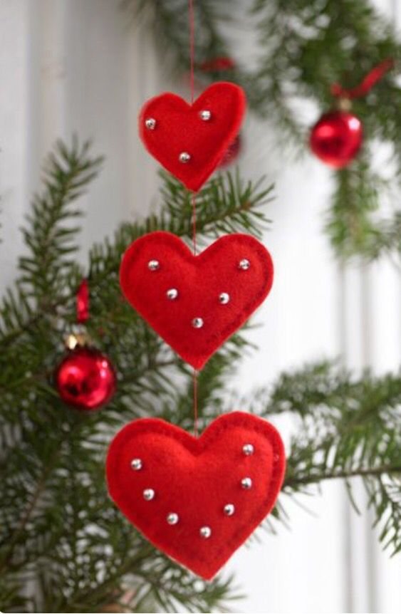 Red felt ornaments embellished with silver beads.