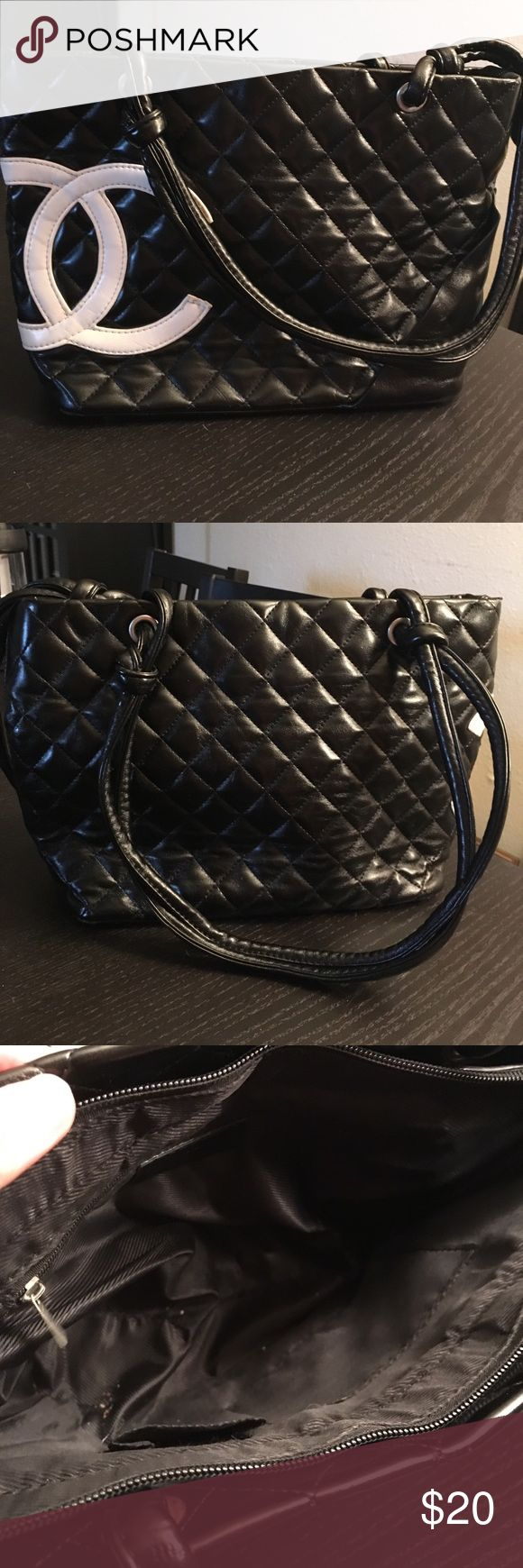 Chanel quilted bag Used condition Chanel shoulder bag. Zippered closure with one zippered pocket inside and two open pockets inside. This bag was well loved and has some wear and tear, as pictured. This is reflected in the price. CHANEL Bags Shoulder Bags