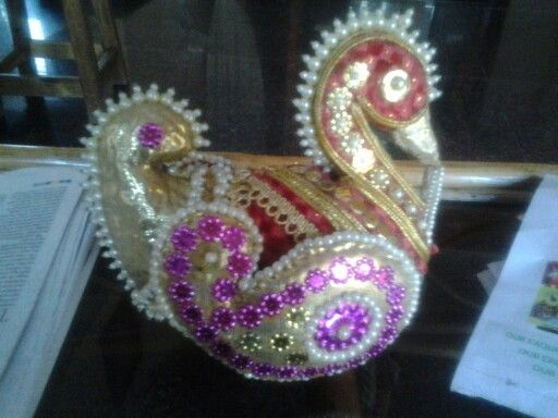 In south Indian weddings coconut is decorated like this