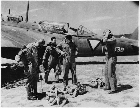 Dutch Pilots Putting on Gear Near Airplane as they Prepare for Air Raid on Japanese Forces During WWII, Dutch East Indies, 1942 - pin by Paolo Marzioli