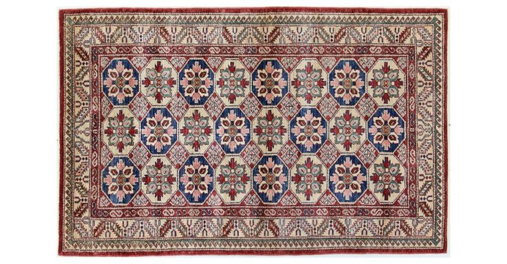 This one-of-a-kind traditional rug is carefully knotted by hand using premium wool in rich tones of red and navy. We recommend using a rug pad to extend the life of the rug and keep it securely in...