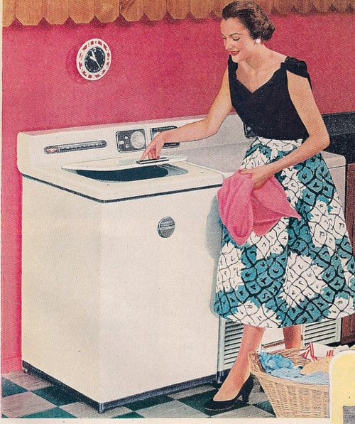 1950s happy housewife laundry.