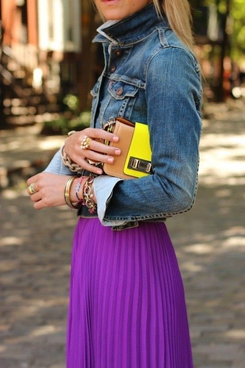 Love the pairing of the pleated girly skirt with the denim jacket and then the pop of neon with the clutch