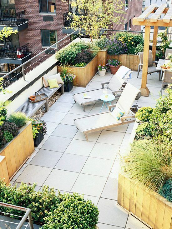 Better Balcony A subtle change in material -- large, regular pavers merge into a soft border of river rock -- keeps a large expanse of flooring from looking boring. A series of planters in various sizes defines the edges of the balcony. Benches (and high metal and wire railing) offer a safe perch for enjoying the view. A trellis delineates a separate dining space on the rooftop. Use a variety of plant types -- dwarf trees, shrubs, a few perennials and annuals -- to draw the eye around, up