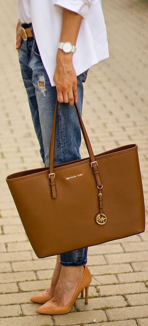 Blue jeans, white blouse and tan handbag