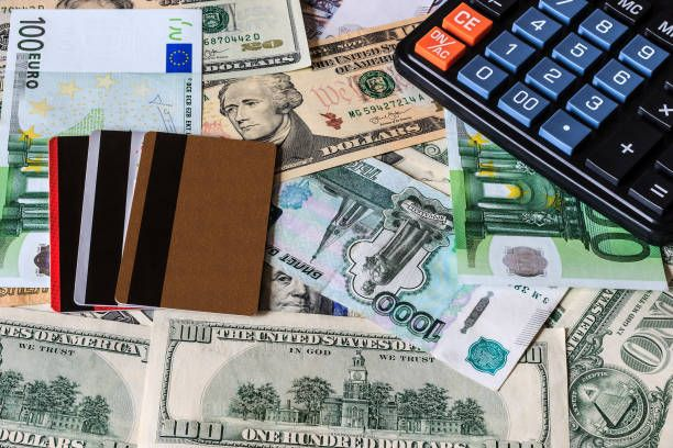 dollar ruble and euro bils credit card and black calculator