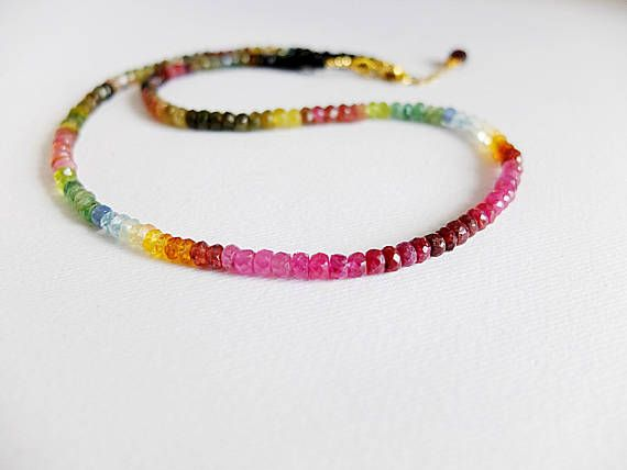 This is a beautiful tourmaline and other gemstones necklace This colorful beautiful precious necklace is made of beautiful natural faceted watermelon tourmaline. I accented the natural shades with red shaded rubies and citrine gemstones.Some aquamarine and emerald beads are present I