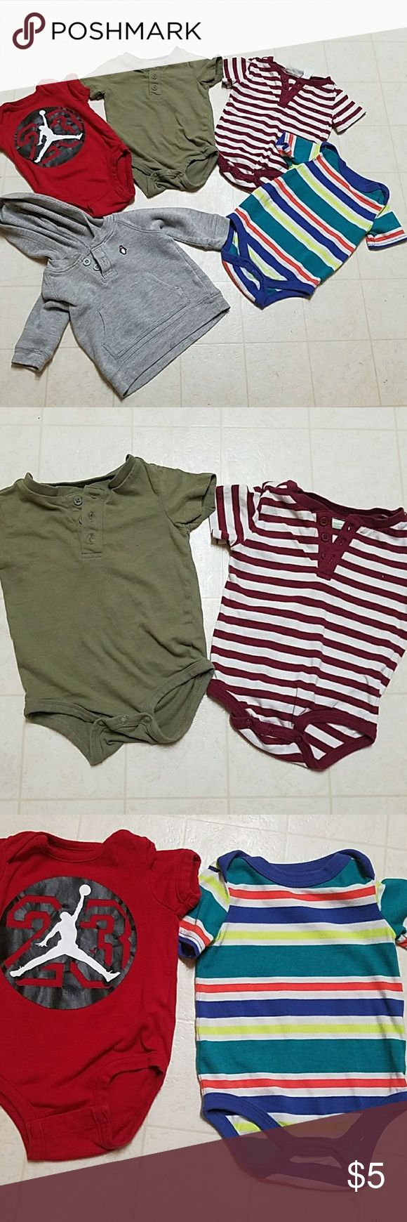 Bundle of boys tops Bundle contains 4 onesies and 1 hooded top. All are in size three to six months. The grey hooded top is made by Carter's. The Michael Jordan is made by Michael Jordan apparel. The multicolored onesie is made by Circo. The solid green and maroon and white striped onesie are made by first impressions. Will not separate bundle. mixed Shirts & Tops