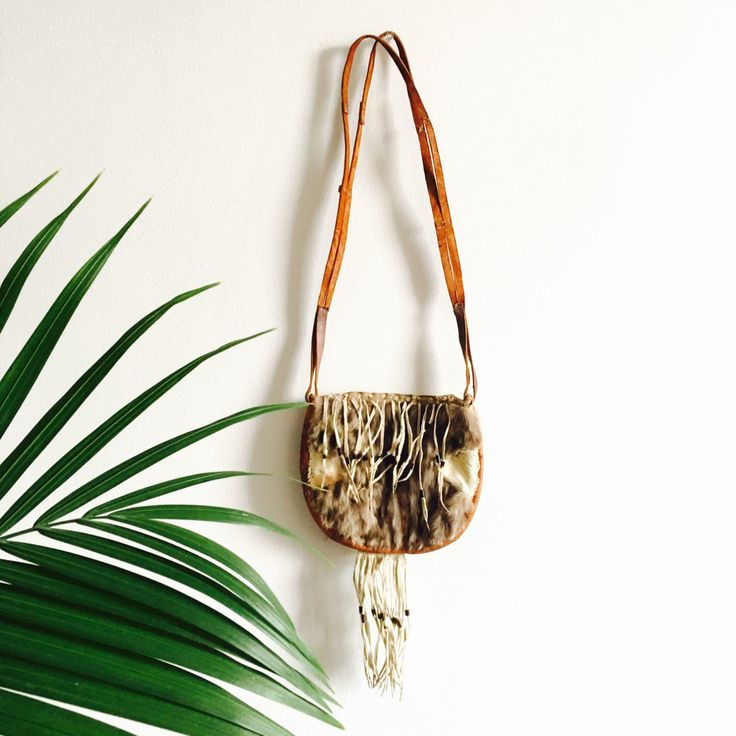 A personal favorite from my Etsy shop https://www.etsy.com/listing/229221784/leather-x-fur-fringe-festival-bag