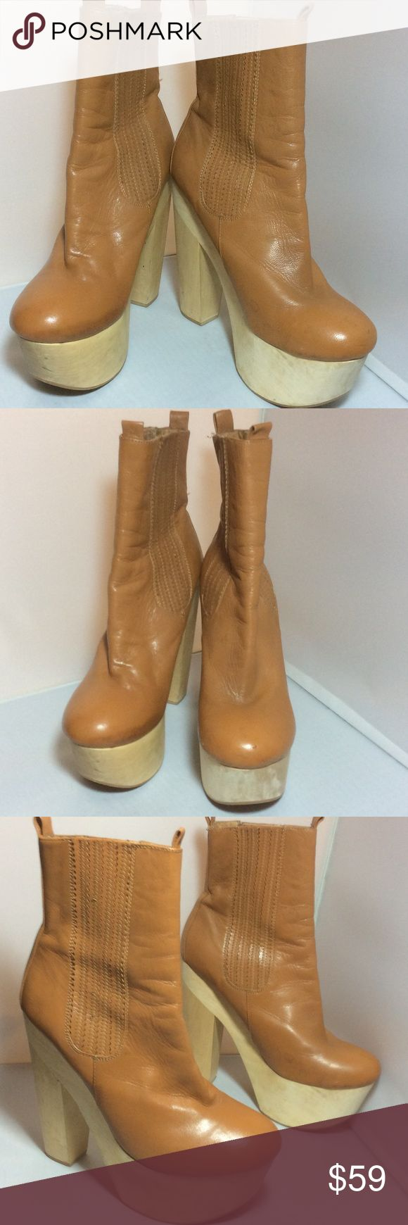 """Chloe Sevigny Mary Jo Tan Platform Booties 10 Flaw Chloe Sevigny Mary Jo Tan Platform Booties 10 Flawed 6"""" wooden heel with 2"""" platform. They are so beautiful but they have been abused so they have flaws and stains NO TRADES PRICE IS FIRM. Opening Ceremony Shoes Ankle Boots & Booties"""