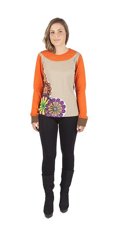 BEYONCE- Original long sleeve t-shirt. Orange and brown. Composition:100% Cotton  Camiseta de manga larga y cuello redondo. Tiene aplicaciones florales en la parte delantera, que es color marrón claro, y sea las mangas que el estampado floral de la parte de atrás es de color naranja. Muy llamativa y original! Composición: 100% Algodón