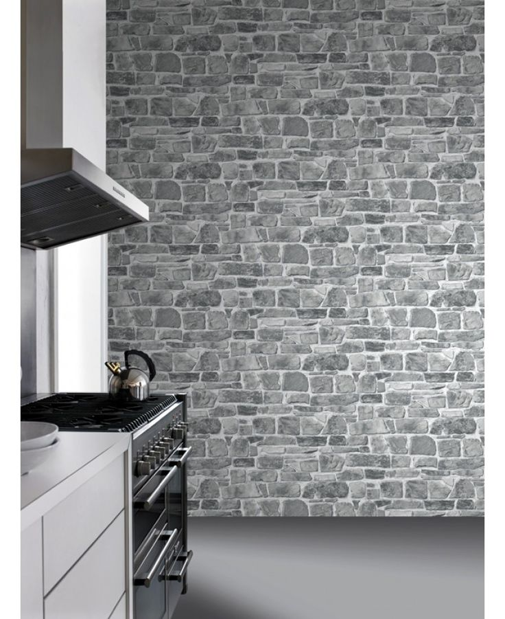 This fantastically realistic Stone Wall Wallpaper features a rustic brick wall print in natural tones of stone grey