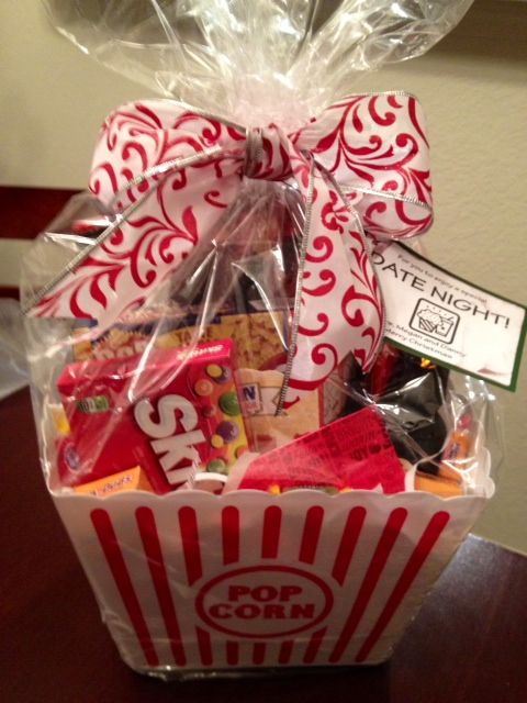 Exactly what we want to do for some gifts....bag of popcorn couple things of candy and a movie or movie tickets and viola a perfect gift for movie lovers:)