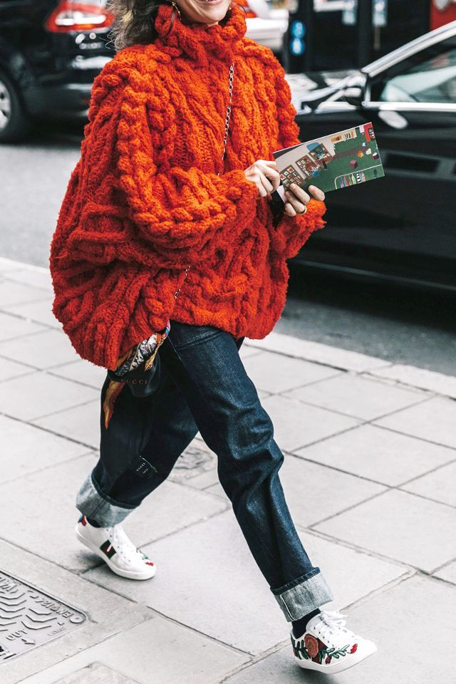 A super-chunky knit looks clean with cuffed jeans and white sneakers.