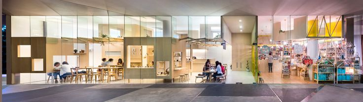 Produce Workshop uses wooden trellis to create connected shops inside Singapore art school