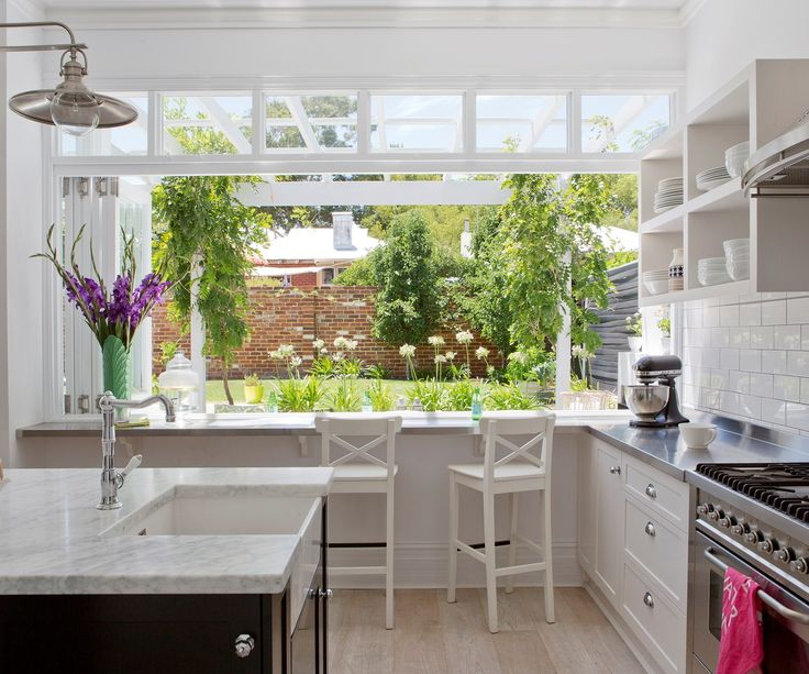 """It doesn't matter how far you live from the beach; a fresh white kitchen that opens to the outdoors can have a cool and casual coastal vibe. [See more of this Perth cottage](http://www.homestolove.com.au/before-and-after-kirk-and-suzannes-perth-cottage-renovation-2325/?utm_campaign=supplier/