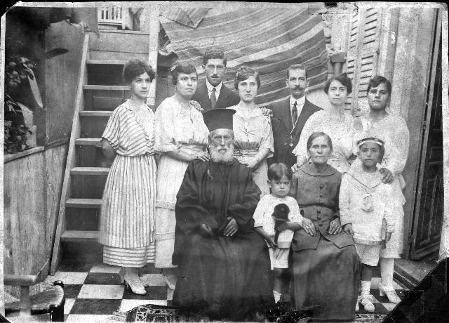 The priest of Saint Panteleimon, father Konstantinos and his family, Moschonisi.