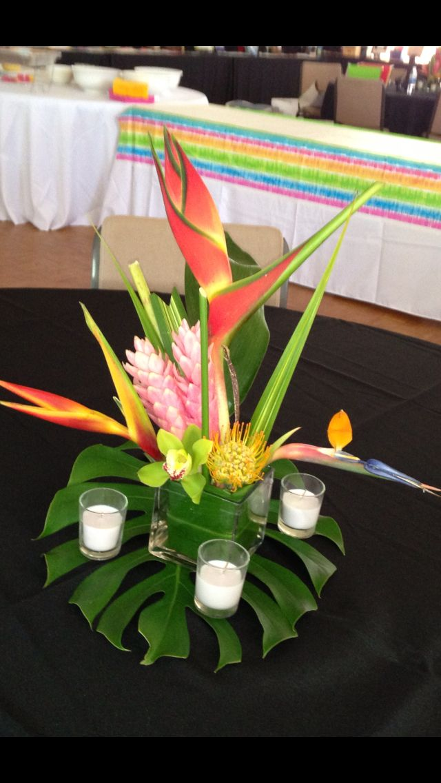 Tropical centerpiece in a plastic container. $65.00