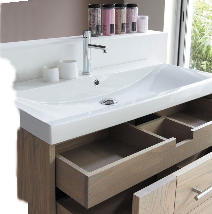 Elegant Floating Unit Includes White Ceramic Basin, Solid Oak Construction And A  Removable Storage Drawer Insert.
