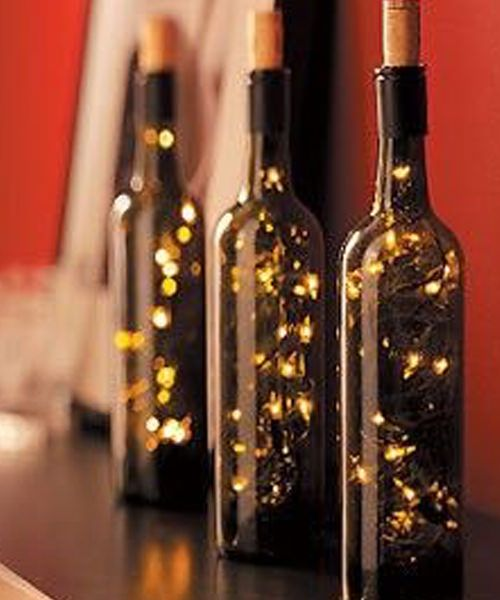 Best 25 bottle centerpieces ideas on pinterest Wine bottle wedding centerpieces