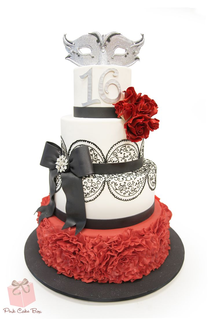 This four tier masquerade themed cake was created for Jorge's sweet 16.  Highlights include lace, ruffles, and red roses.  Enjoy!
