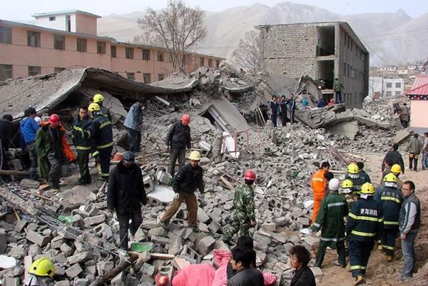 Earthquakes Today | Picture of rescuers searching rubble of the China earthquake today.