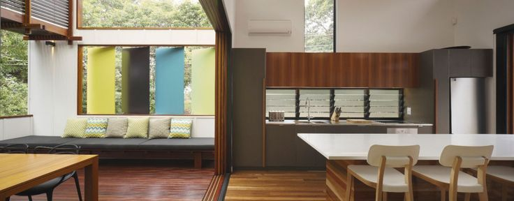 Good kitchen to logia space. Like the color and materials. Mooloomba House by Shaun Lockyer Architects