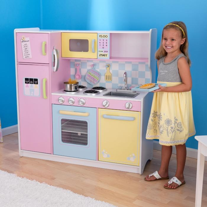 For the little chef in your life the brightly colored KidKraft Deluxe Pastel Playkitchen is sure to encourage active play and imagination. The large play kitchen has enough room for the head chef and assistants with room to spare. Perfect for hours of endless cooking, baking and fun the Kidkraft play kitchen set comes complete with all the appliances for your youngster to cook up a feast all the while encouraging imagination and play. -The playkitchen comes complete with refrigerator…