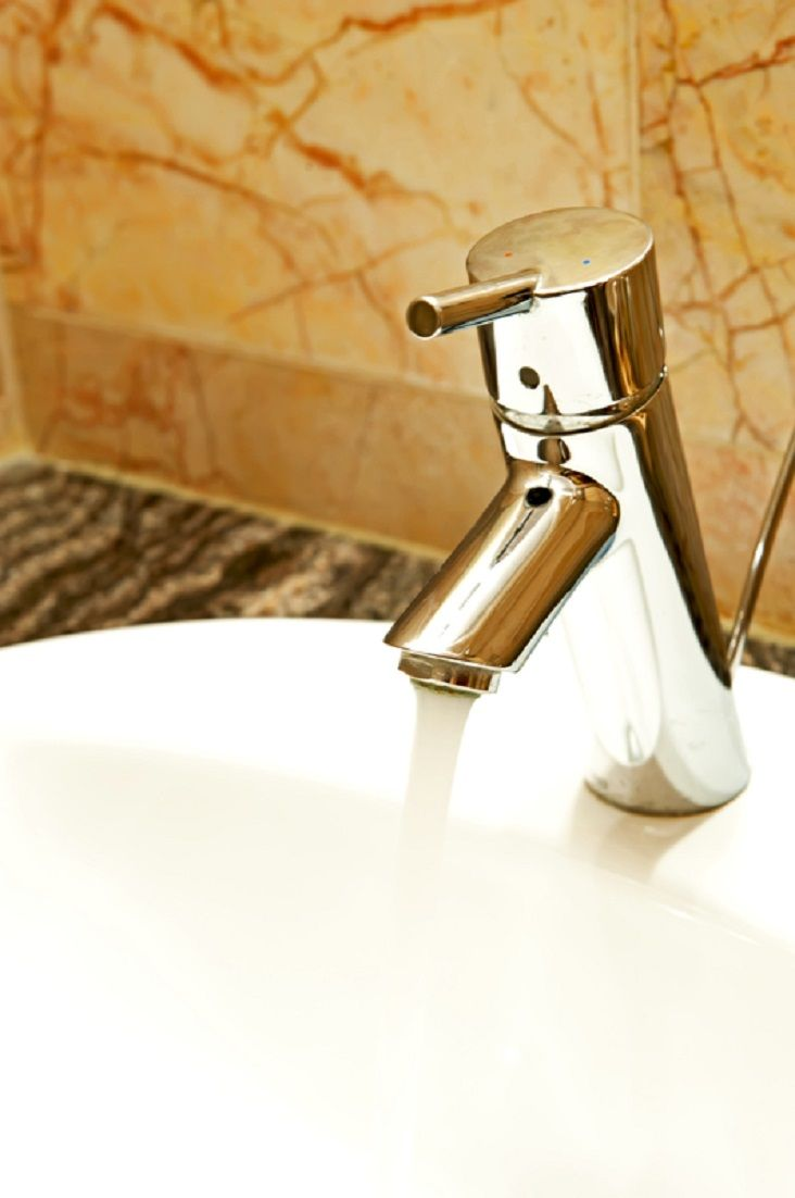 Closeup Of A Chrome Faucet And Porcelain Sink With Images
