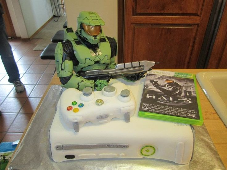 White Xbox 360 Halo Console & Controller - Console is Cake covered & decorated w/ fondant.  The controller is Rice Krispie Treat covered & decorated w/ fondant.  Did not make Halo Guy or case.