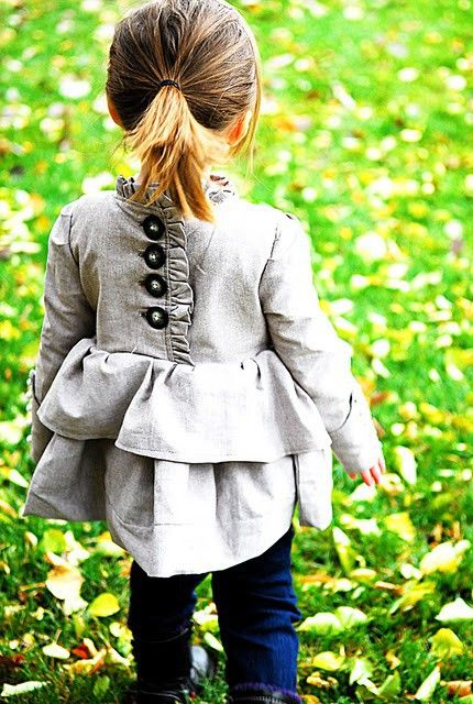 I love the details of this shirt (jacket?)  That back is lovely. Reminds me of the Sugar City Frock pattern (one version here: http://www.dana-made-it.com/2009/01/doll-frock.html)  Makes me want to pull out the pattern again for the new babe