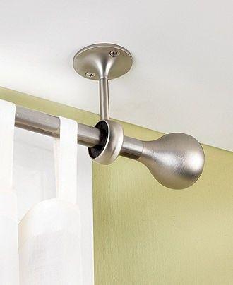 Hang curtains from the ceiling. Avoid measuring and makes ceilings look taller!