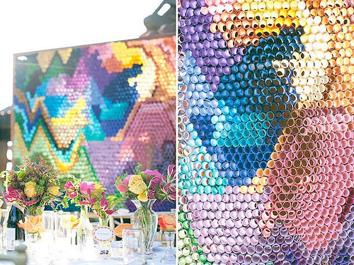 life-size lite brite!!! it looks like paper strips rolled up and stuffed into chicken wire, like pomping a parade float. (flashback to college homecoming!) it's used here as an amazing backdrop at a wedding reception.