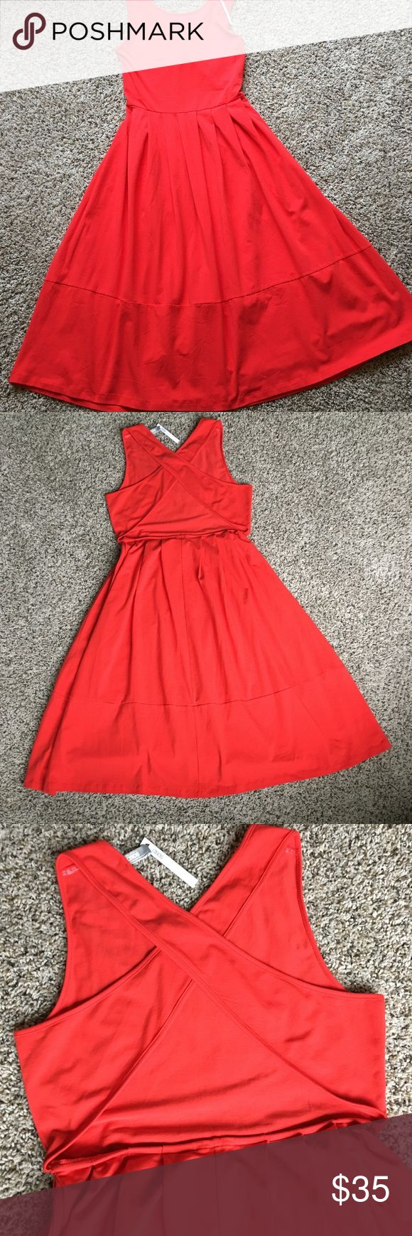 Beautiful Red Dress with open back Size 14 Midi This beautiful cotton red dress is a summertime flirty number that is sure to land you on the best dressed headline! The cross cross back is an added feature and a nice surprise when walking away. Size 14 Midi Length Asos Dresses Midi