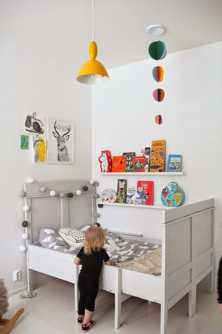 the boo and the boy: eclectic kids' rooms. Picture rail for 'library' against the bed, for bedtime stories.