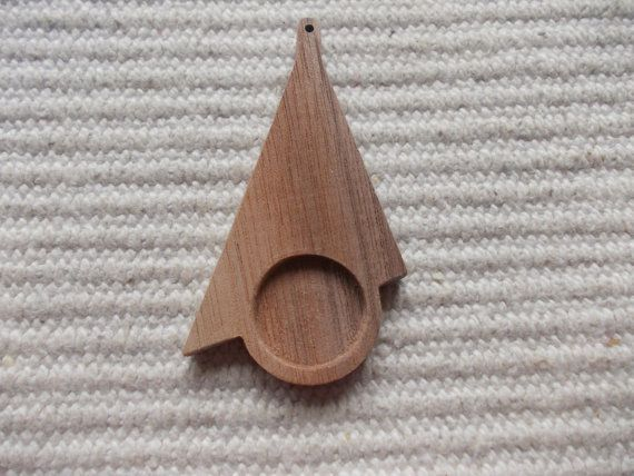 1 p unfinished unique long triangle wooden pendant base with 18 mm cabochon frame  Unfinished, natural dark walnut wood long triangle-shaped pendant/earrings base for jewel making. Triangle wood supply. Triangle wood bezel, triangle blank wood, triangle wood supply, triangle jewel supply, art supply https://www.etsy.com/listing/235005486/new-1-p-unfinished-unique-long-triangle?