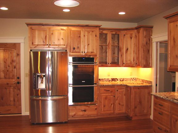 Natural knotty alder wood kitchen cabinets popular for Kitchen cabinets reno