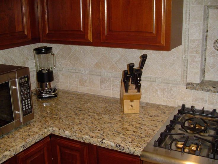 Cecelia Grantie Countertop With Travertine Backsplash