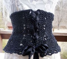 Crochet corset... anyone with the figure to pull this off want me to make one for them?  Could be really cute over a white collared shirt.. hmm.