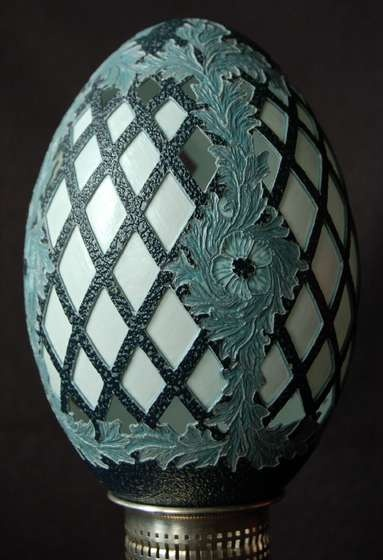 emu egg shell carving - there are 3 layers of color in the emu shell, black on the exterior, gray in the center, and white in the last layer. There is no paint on this eggshell! Just beautiful!
