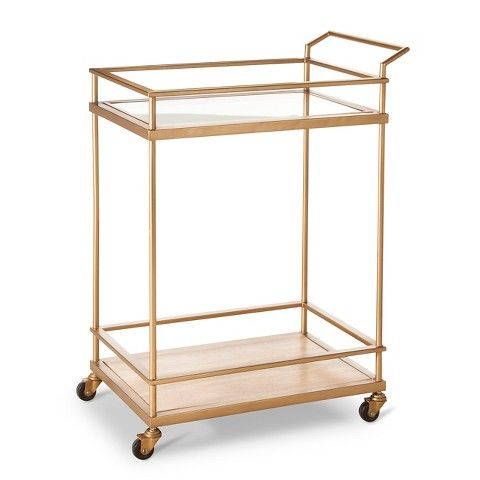 "Threshold™ Bar Cart - Gold, $129.99, Target. ""That'a really nice sort of transitional look. You could mix that in a lot of interiors."" --Skip Sroka. 36"" tall."