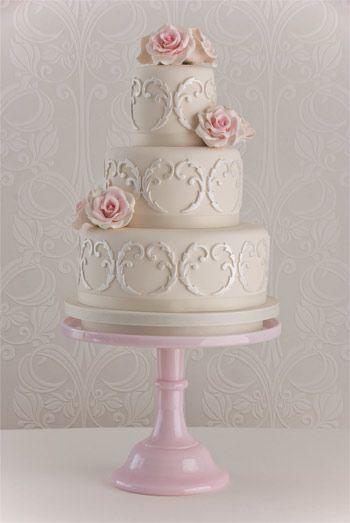 'Filigree Rose' wedding cake: Madagascar vanilla bean cake,  Amedei Chuao chocolate buttercream, grosgrain ribbon,  handmade sugar roses, sugar filigree