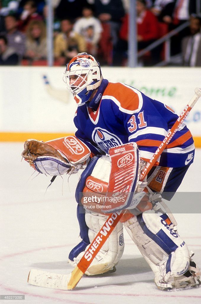 goalie-grant-fuhr-of-the-edmonton-oilers-defends-the-net-during-an-picture-id482270092 (679×1024)
