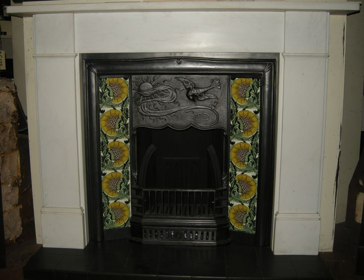 Another fireplace tile set installation to show you here; this time with a floral, dandelion design. The contrast of the yellow flowers to the grey of the Cast Iron Fireplace really make a statement.  All information about our tiles can be found on our website; colours can be amended and different sizes are available.