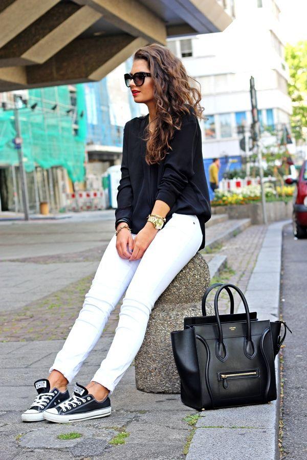 Shop this look on Lookastic:  http://lookastic.com/women/looks/sunglasses-long-sleeve-blouse-watch-skinny-jeans-low-top-sneakers-tote-bag/6374  — Black Sunglasses  — Black Long Sleeve Blouse  — Gold Watch  — White Skinny Jeans  — Black and White Low Top Sneakers  — Black Leather Tote Bag