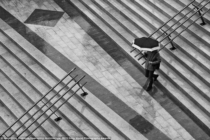 Angles and lines: Photographer Ionut Cirja captutres the essence of modern Romania Architecture in this neat black and white photograph taken in the town of Piatra Neamt.