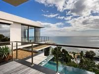 Regal 4 bedroom House for rent in Bantry Bay. This three levels spacious villa embodies vibrant and modern distinctive design that merges with its waterscapes and multiple double volume spaces for living and entertaining